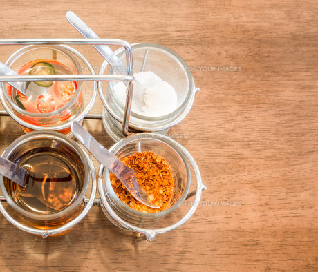 Thai Condiment for Noodle with Four Glasses of Ingredientの写真素材 [FYI00644534]