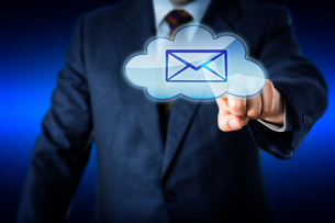 Business Man Touching Email In Blue Cloud Iconの写真素材 [FYI00644562]