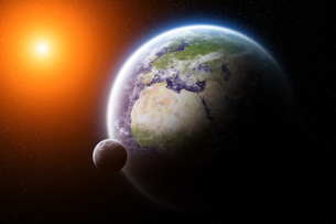 Sunrise over planet Earth in spaceの写真素材 [FYI00644602]