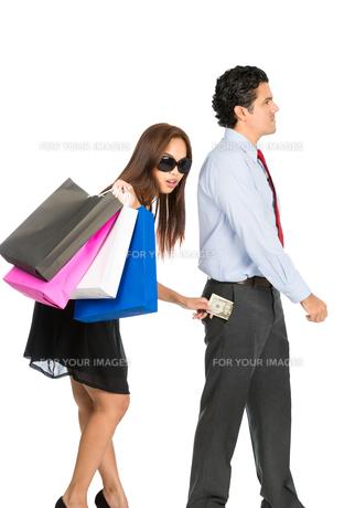 Asian Wife Stealing Money Husband Pocket Walkingの写真素材 [FYI00644694]