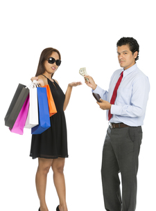 Asian Woman Shopper Accepting Money Husband At Vの写真素材 [FYI00644697]