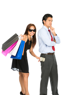 Shopping Smiling Female Removing Money Husband Vの写真素材 [FYI00644703]