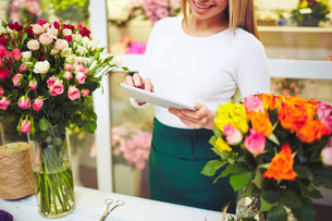 Florist with touchpadの写真素材 [FYI00644983]