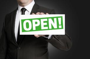 open shield is held by businessmanの写真素材 [FYI00645037]