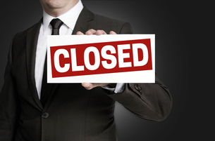 closed shield is held by businessmanの写真素材 [FYI00645040]