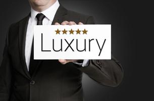 luxury shield is held by businessmanの写真素材 [FYI00645043]