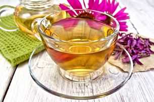 Tea Echinacea in glass cup on board with napkinの写真素材 [FYI00645434]