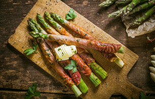 Asparagus Wrapped in Bacon with Curl of Butterの写真素材 [FYI00645905]