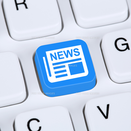 internet concept online newspaper news on computerの写真素材 [FYI00646131]