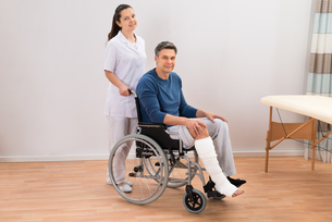 Doctor With Disabled Patient On Wheelchairの写真素材 [FYI00646510]