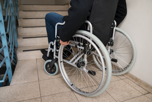 Man On Wheelchair In Front Of Staircaseの写真素材 [FYI00646584]