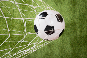 Soccer Ball In Netの写真素材 [FYI00646685]
