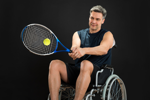 Disabled Player Playing Tennisの写真素材 [FYI00646700]