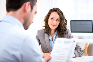 Young attractive woman during job interviewの写真素材 [FYI00647304]