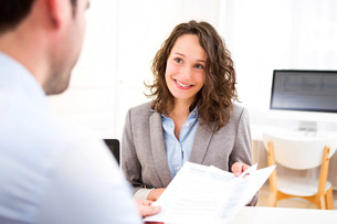 Young attractive woman during job interviewの写真素材 [FYI00647333]