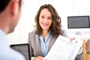 Young attractive woman during job interviewの写真素材 [FYI00647334]