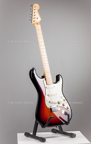Electric guitar isolated on gray backgroundの写真素材 [FYI00647430]