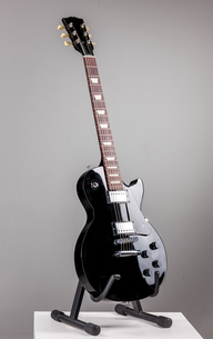Electric guitar isolated on gray backgroundの写真素材 [FYI00647432]