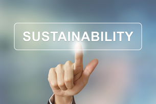 business hand clicking sustainability button on blurred backgroundの写真素材 [FYI00647514]