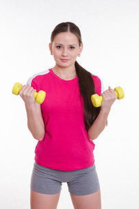 The athlete pumps weights both handsの写真素材 [FYI00647673]