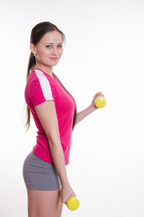 Athlete performs workout two dumbbellsの写真素材 [FYI00647676]