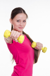 Sportswoman with two dumbbells in the hands ofの写真素材 [FYI00647679]