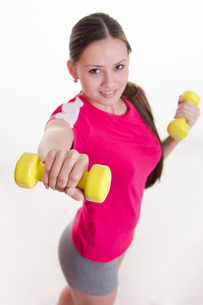 Dumbbells in the hands of athletesの写真素材 [FYI00647681]