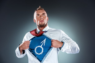 businessman acting like a super hero and tearing his shirt offの写真素材 [FYI00647781]