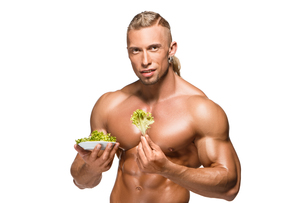 Shaped and healthy body man holding a fresh lettuce,  isolated on white backgroundの写真素材 [FYI00647974]