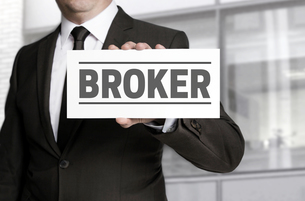 broker shield is held by businessmanの写真素材 [FYI00648121]