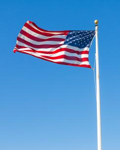 American flag against blue skyの写真素材 [FYI00648205]