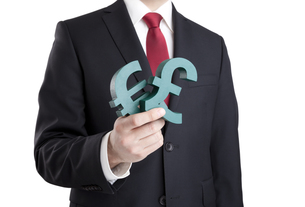 Businessman holding euro and pound signs with clipping pathの写真素材 [FYI00648887]