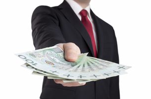 Businessman holding polish money. Clipping path included.の写真素材 [FYI00648889]