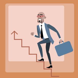 African businessman climbs the career ladderの写真素材 [FYI00649257]