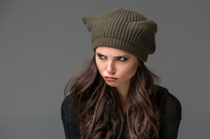 Beautiful sexy young woman in a  funny hat with earsの写真素材 [FYI00649439]