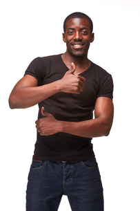 The smiling african man as black businessman with green panel, isolated on white background. Positive human emotions and advertising of somethingの写真素材 [FYI00649447]