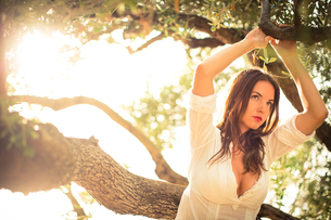 Attractive, young brunette on the beach, amid olive trees, looking both sensual and naturalの写真素材 [FYI00650247]
