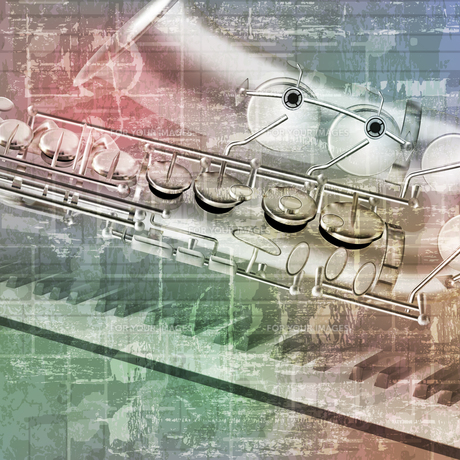 abstract grunge background with saxophone and piano keysの写真素材 [FYI00650343]