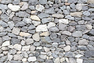 gray stone wall as backgroundの写真素材 [FYI00650534]