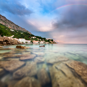 Rainbow over Rocky Beach and Small Village after the Rain, Dalmatia, Croatiaの写真素材 [FYI00650611]