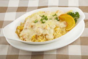 Shrimp and rice severed covered with a delicious sauceの写真素材 [FYI00651415]