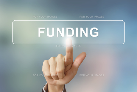 business hand clicking funding button on blurred backgroundの写真素材 [FYI00651957]