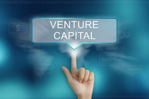 hand clicking on venture capital buttonの写真素材 [FYI00651964]