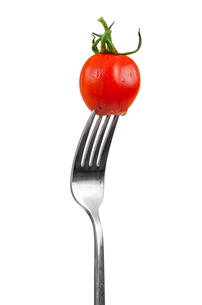cherry tomato on a forkの写真素材 [FYI00652108]