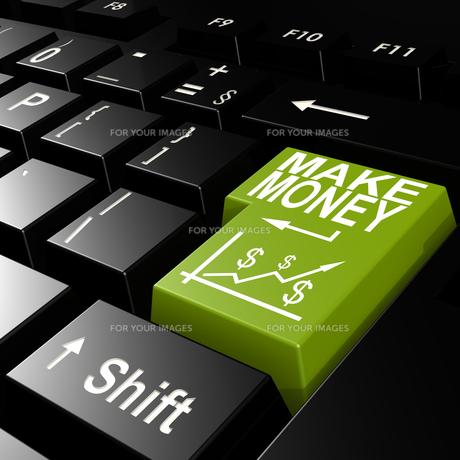 Make money word on the green enter keyboardの写真素材 [FYI00652182]