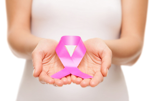 Woman holding a pink cancer awareness ribbonの素材 [FYI00652243]