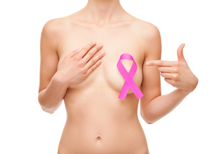 Woman with a breast cancer awareness ribbonの写真素材 [FYI00652249]