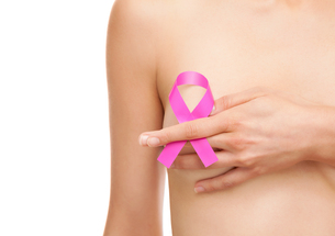 Woman with a breast cancer awareness ribbonの素材 [FYI00652250]