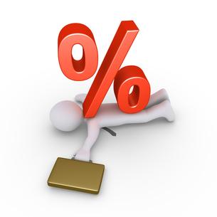 Businessman crushed by percent symbolの写真素材 [FYI00652450]