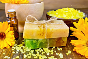 Soap homemade and salt with calendula on boardの写真素材 [FYI00652645]